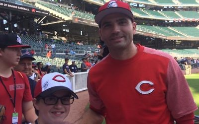 Adam Koss poses for a photo with Reds first basemen Joey Votto at SunTrust Park.