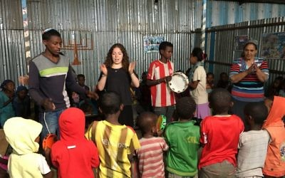 Dalia Hartstein teaches Ethiopian children some Hebrew songs.