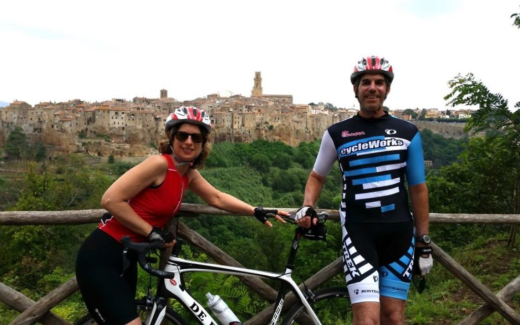 Debra and David Levinson take a break from a bike ride near the medieval village of Pitigliano, known as Little Jerusalem.