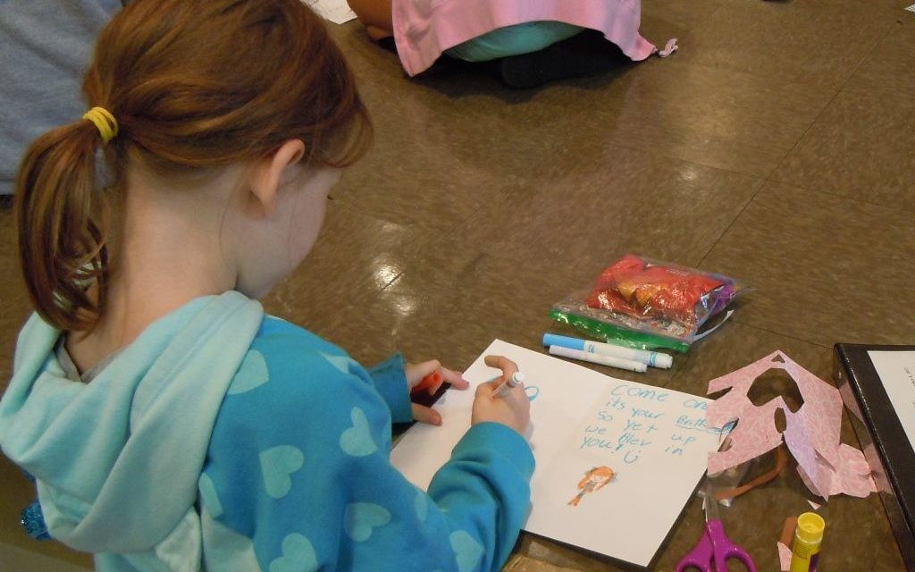 While the adults were in the sanctuary and other parts of Temple Emanu-El talking about problems and policies Oct. 22, religious school students were in the social hall, working on cards and care packages for distribution through The Packaged Good.