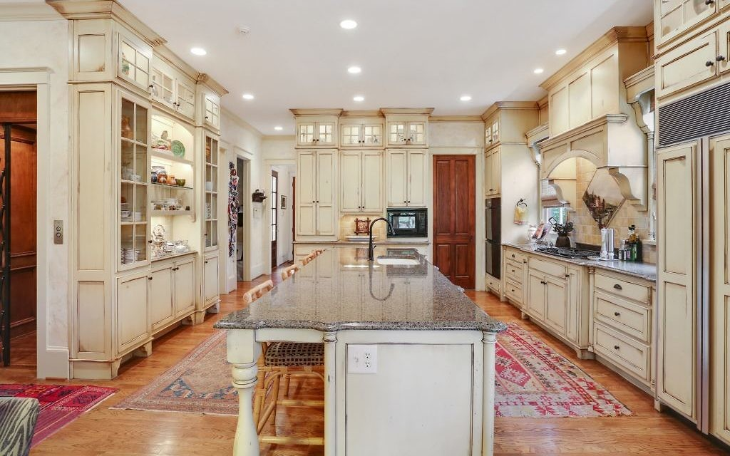 The expansive kitchen counters are granite and often serve as bars or buffets at parties.