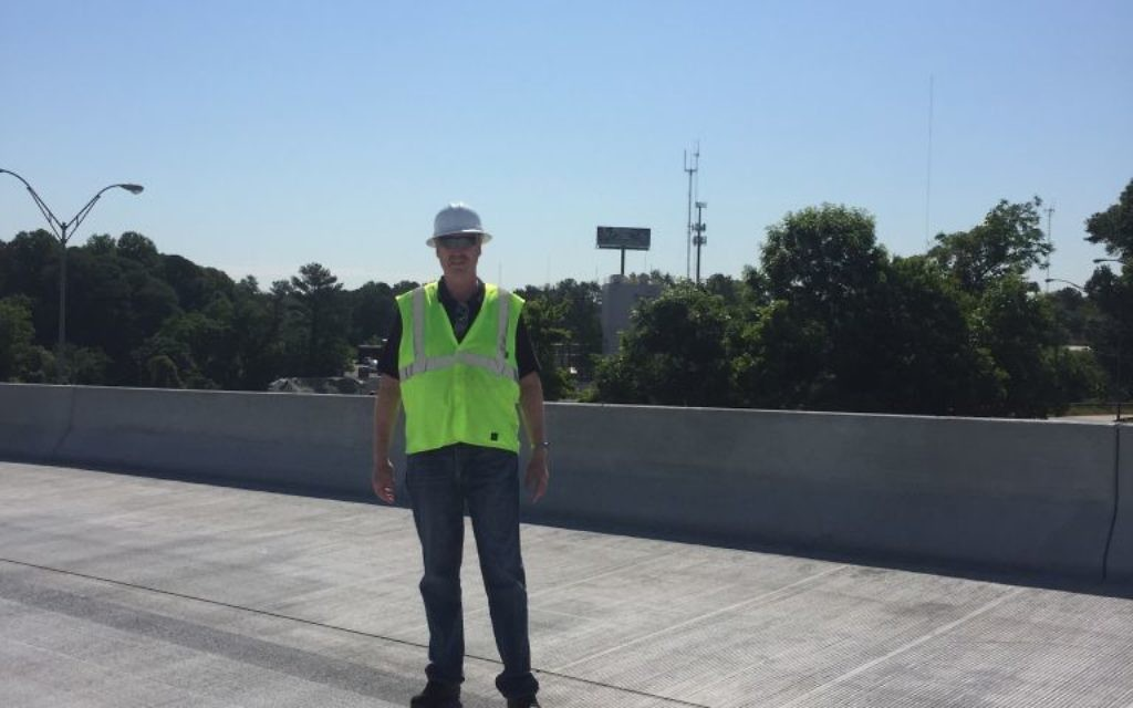 Chemist Jerry Rademan stands on the restored I-85 bridge.