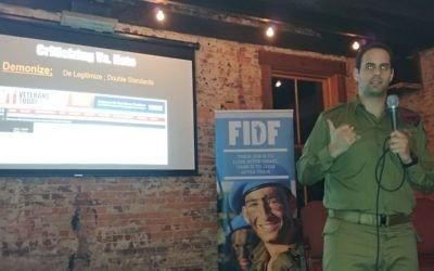 Ran Bar-Yoshafat speaks to FIDF young professionals about strengthening America's support for Israel on Oct. 24 at Southbound.