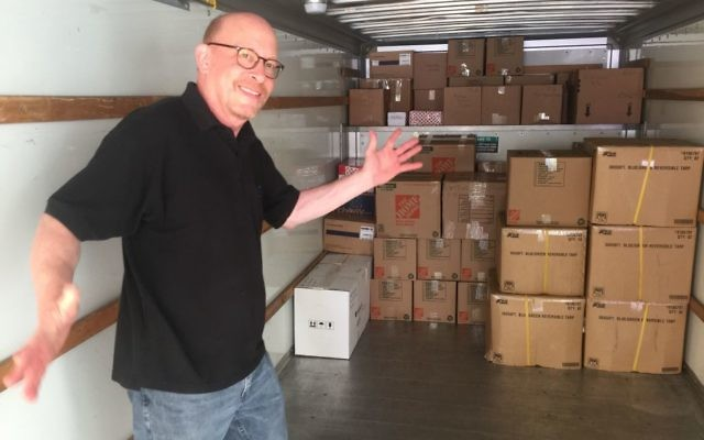 Aprio managing director Robert Melnick arranges boxes to maximize space in a U-Haul truck bound to Miami with relief supplies.