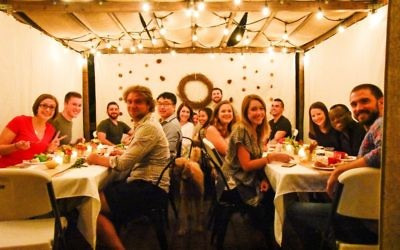 Night time is the right time for a sukkah meal in this photo sent by Elizabeth Rowland.