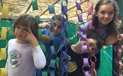 As Mara Block's sukkah photo shows, you can't go wrong with construction-paper chains for decorations.