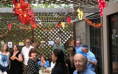 Continuing a 15-year tradition, the Siegel family sukkah includes the handiwork of Lou Schloss, now 92.