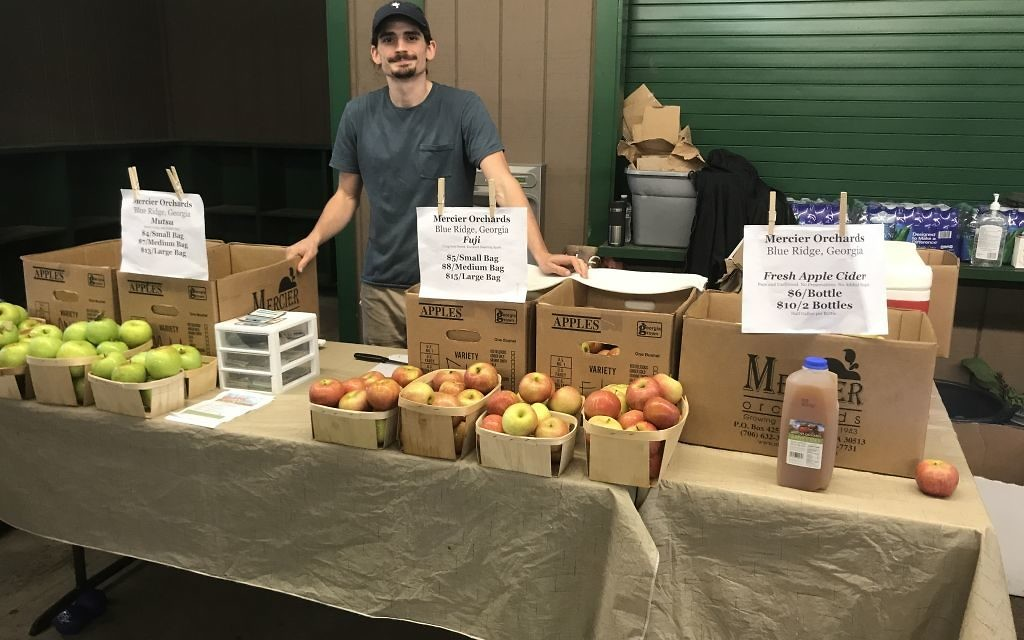 Steven Goyne of Mercier Orchards poses with some favorite apple varieties at the first annual Sukkot Farm-to-Table Festival Oct. 8.