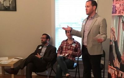 While his fraternity brother, Congregation Shearith Israel Rabbi Ari Kaiman, and Eli Harrison listen, Lander Gold, the senior director of advancement and philanthropic partnerships for Moishe House, tells about the organization's origins in 2006 in Oakland, Calif., when three friends decided to hold a Shabbat dinner and ended up hosting more than 70 young adults.