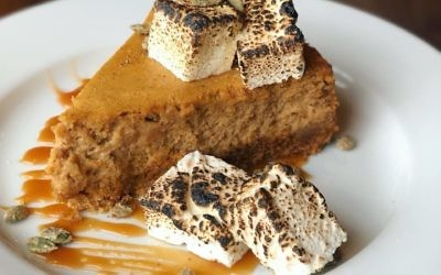 Photo courtesy of Oak Steakhouse Oak Steakhouse's Sweet Potato Cheesecake screams autumn with a gingersnap crust, candied pumpkin seeds and caramel sauce, as well as house-made marshmallows.