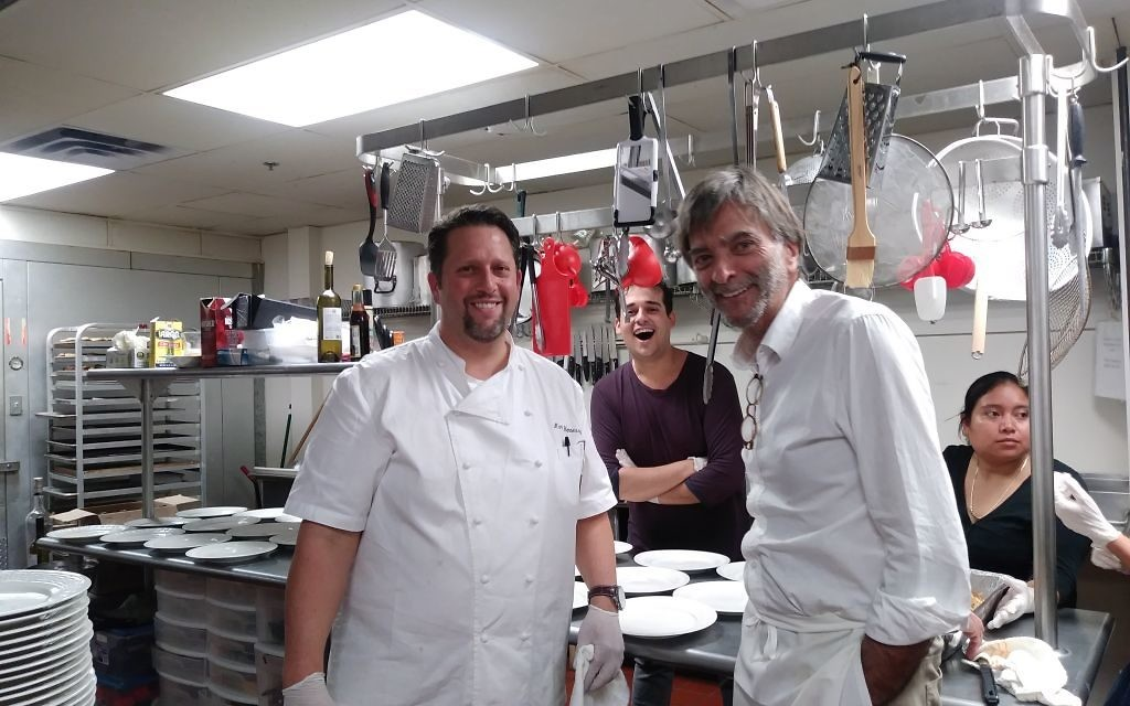 Photo by Patrice Worthy (From left) Mark Hennessey, Michael Kosowski and Jose Meirelles keep busy in the kitchen at Congregation Beth Tefillah.