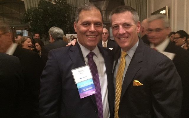 Birthright Israel Foundation honoree Doug Ross celebrates with Temple Sinai Rabbi Ron Segal in November.