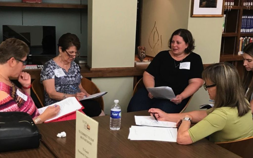 "Educators at the Atlanta Jewish Education Directors Council's annual professional development kallah at Temple Sinai on Aug. 13 participate in ""Teaching Jewish Texts Through Music,"" a session led by Eli Sperling of the Center for Israel Education."