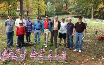 Volunteering at Crest Lawn Memorial Park are (from right) Henry Levine, Steve Edelkind, Mark Hauler, Steven Tabb, Alan Wind, Seymour Levine, George Heart and family, and Jay Bailey.