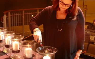 Book Festival author and guest speaker Alexandra Zapruder lights the last candle.