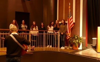 Singing under the direction of Drew Cohen are Weber School students (from left) Chloe Deutsch, Natalie Abramova, Leah Cohen, May Abravanel, Lindsey Gelernter, Rebecca Glusman and Shayna Fraley.