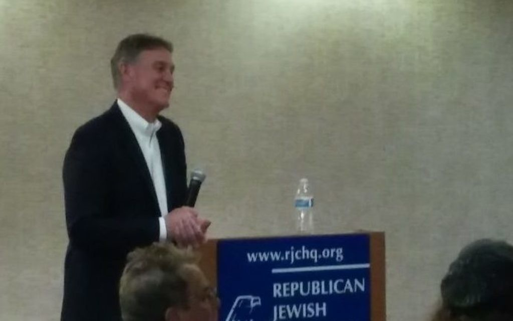 Sen. David Perdue takes a question at a meeting of the Republican Jewish Coalition, which in 2014 was the only group to give him a straw-poll victory before the Senate primary.