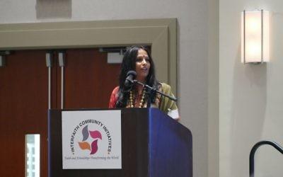 Suchetta Kamath of the Santan Mandir Atlanta Hindu Temple gives the opening invocation.