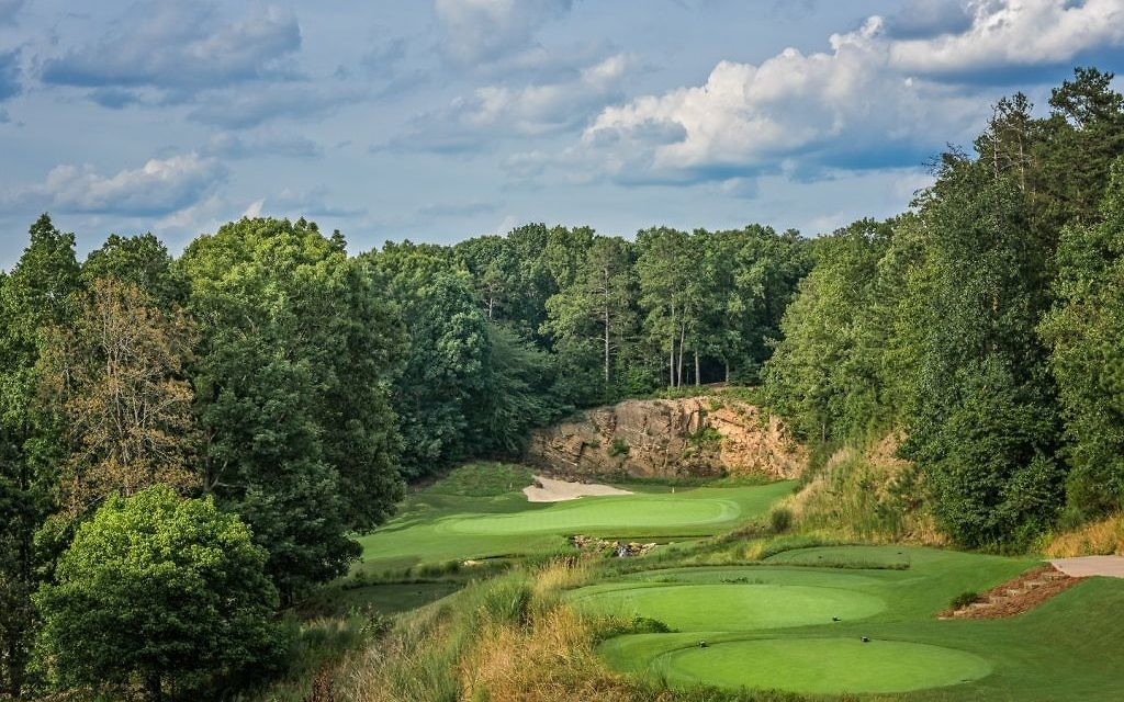 The par-3 17th at the Standard Club is the signature hole of the course, which was fully redesigned in 2005 by golf course architect Mike Riley.