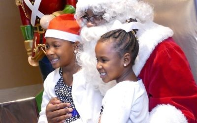 Santa Claus is a big deal for the party attendees, if not necessarily the hundreds of Jewish volunteers.