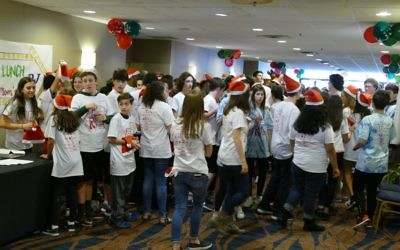 Teen volunteers crowd into the main hallway of the Ramada, waiting to be paired up with children for the afternoon.