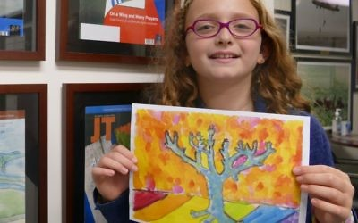 Marion Kogon poses with her prize winning artwork.