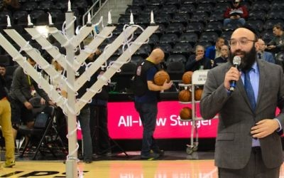 Rabbi Isser New of Chabad of Georgia and Congregation Beth Tefillah welcomes the crowd to Jewish Heritage Night at Philips Arena.