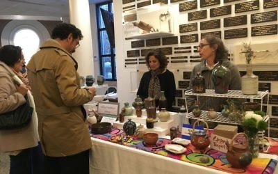 Abby Friedman (right) showcases her handmade ceramics at the 2017 OVS Chanukah Bazaar.