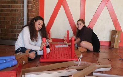 Weber School students work to prepare the preschool space for Los Niños Primero.