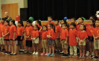 The Los Niños Primero chorus performs at a fiesta.