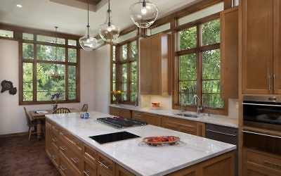 The kitchen has custom cabinets made of Canadian maple and wood flooring composed of squares crosscut from Oregon trees to show the rings. Each square is unique.