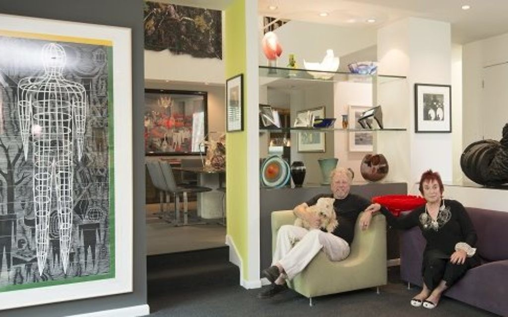 """Harvey and Lakeland terrier Remy Mae relax with Eve Mannes in their art-filled home, which includes a life-size print by John Buck (left) and a black sculpture titled """"Cauldron"""" by Heide Fasnacht. (Photo by Duane Stork)"""