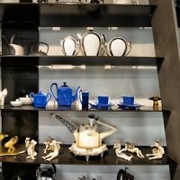 Eve Mannes' fondness of mixing new and old, high and low, is evident in a kitchen collection that includes a Parisian art deco coffee and tea service, a limited-edition coffee set by artist Arman, work by Ukrainian artist Sergei Isupov and Japanese artist Joan Takayama-Ogawa, and a Dorothy Hafner teapot set.