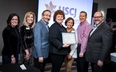 Cantor Jen Brown (left), the co-chair of USCJ's award committee, Margo Gold (second from left), the USCJ president and an Ahavath Achim Synagogue member, and Rabbi Steven Wernick (right), the USCJ CEO, present the Solomon Schechter Award to Congregation Beth Shalom Rabbi Mark Zimmerman, Director of Lifelong Learning Linda Zimmerman, Executive Director Loli Gross and President Howard Fish. (Photo courtesy of USCJ)