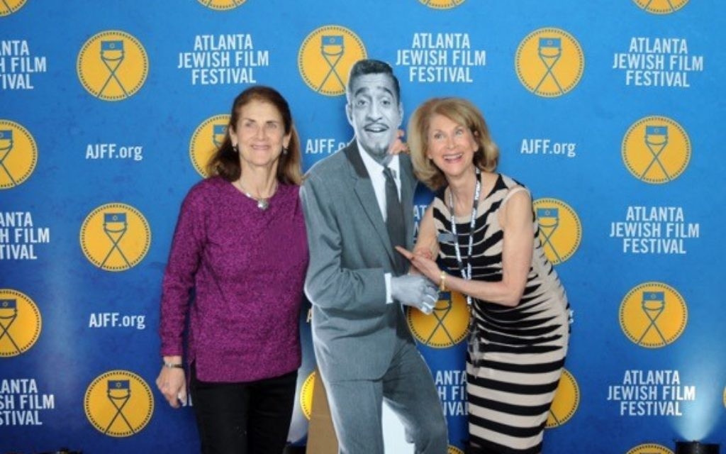 Susan Caller (left) and Marcia Caller Jaffe have fun with Sammy Davis Jr. on the red carpet, where Button It Up took and distributed free photos of gala attendees.