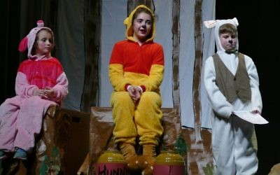 Winnie the Pooh (fourth-grader Rebecca Hatami) asks Rabbit (fourth-grader Avi Yaschik) if he can help him read a note from Christopher Robin.