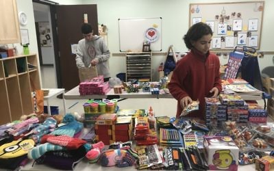 Max (left), 14, and Manny Pargman, 11, organize donations for Lake Forest Elementary School. Congregation B'nai Torah participates in projects each year to provide holiday gifts to needy children at the public school in Sandy Springs.