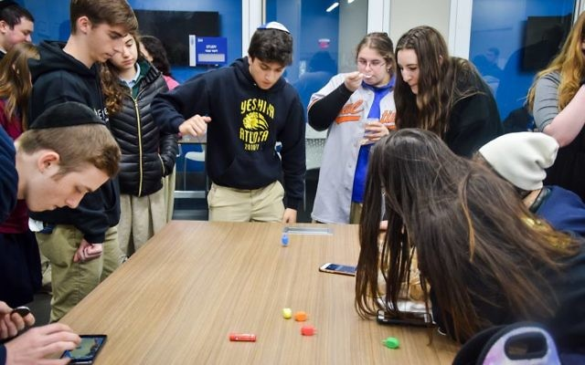 Atlanta Jewish Academy Upper School students participate in a dreidel competition.