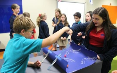 Davis Academy sixth-graders play a dreidel variation called Rabbi of the Spinogogue.