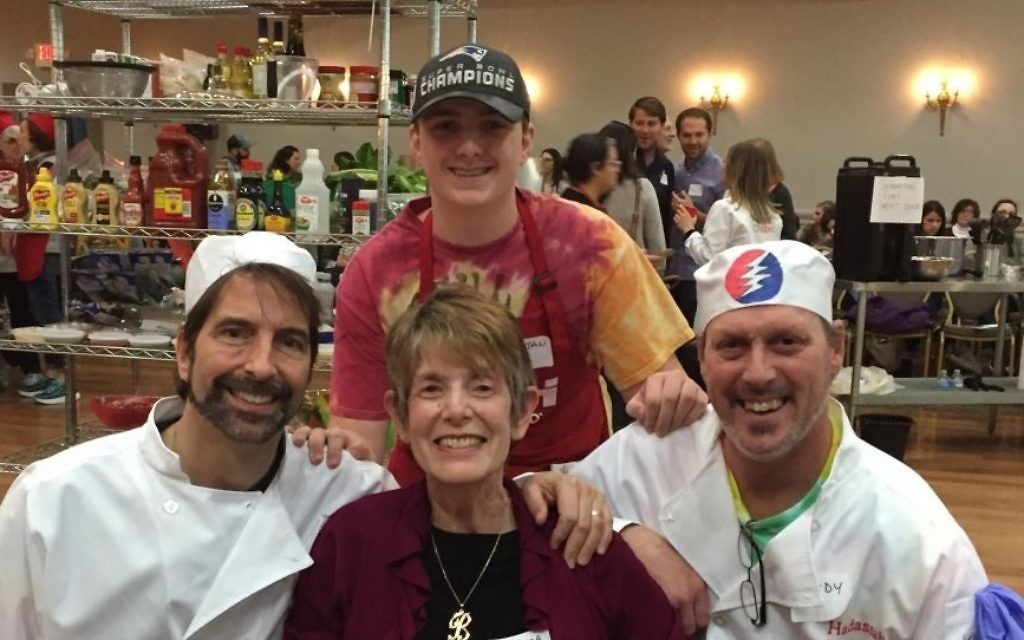 Hash Slingers members Glen Caruso, Tristan Stenmark and Andy Stenmark surround event co-chair Barbara Lang.