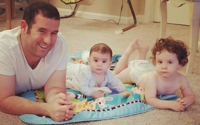 Shaked Angel, shown with his young children, has been in Atlanta since July.