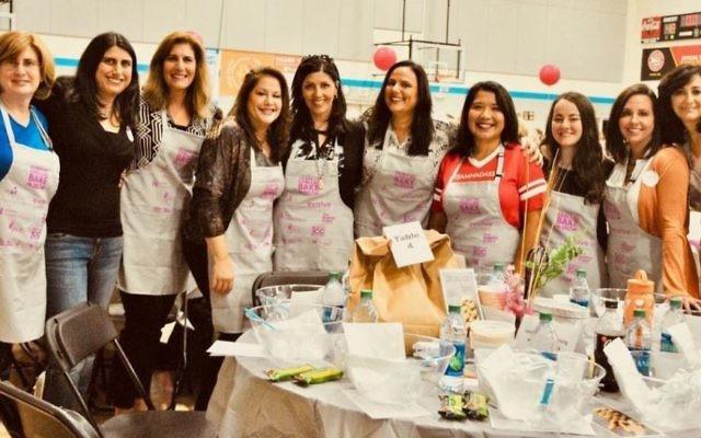 Participating in the Great Big Challah Bake are (from left) Joanna Shuman, Tovah Shraga, Lisa Morchower, Robyn Senoff, Lisa Goldstein, Cheryl Feingold Dorchinsky, Patricia Johnson, Molly Antebi, Kim Green and Judy Antebi Chyatte.