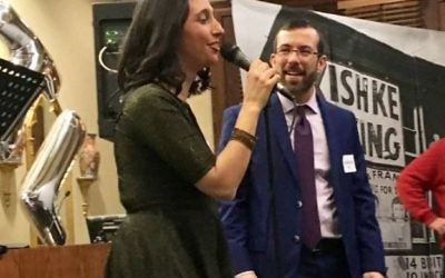 "Emily Kaiman surprises her husband, Rabbi Ari Kaiman and brings down the house at the party with a rendition of Elton John's ""Your Song,"" which her husband played for her in an airport when they were dating."