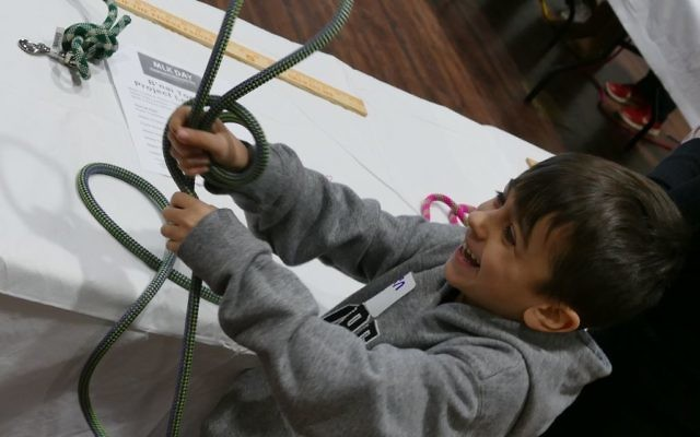 The Atlanta Rescue Dog Cafe leash-making station proves popular and provides fun for children helping repurpose old climbing ropes.