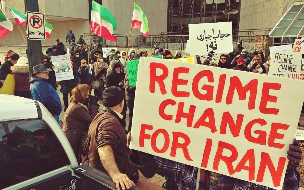 Iranian-Americans gather in front of the CNN Center on Sunday, Jan. 7, to show solidarity with protesters in Iran.
