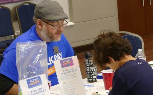 ALEF Fund manager Jared Novoseller checks in a volunteer at B'nai Torah.