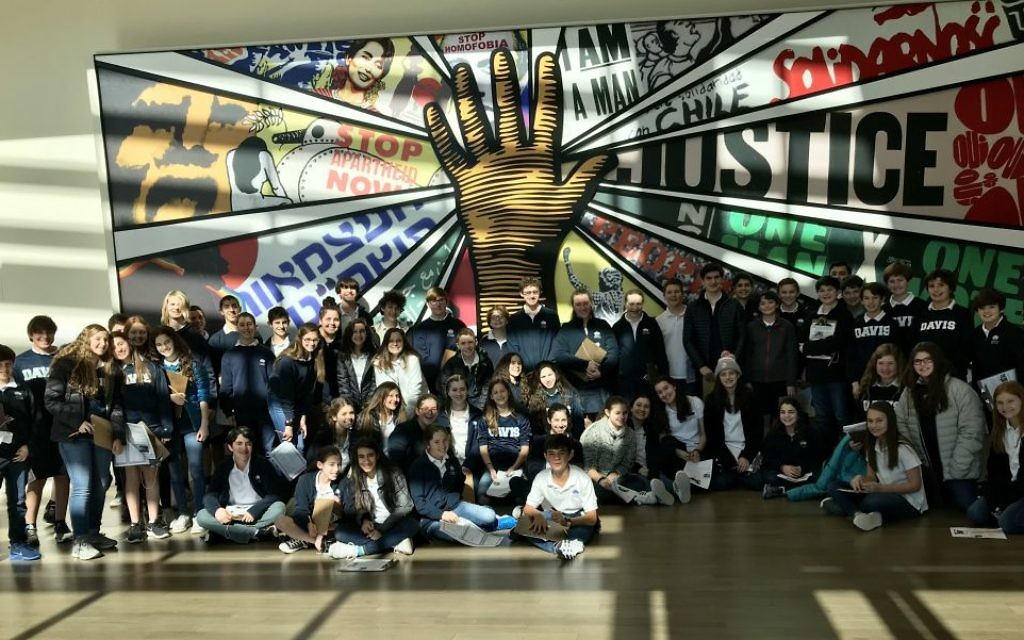 Seventh-graders from the Davis Academy explore the National Center for Civil and Human Rights during an educational excursion.