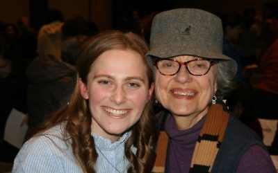 Twelfth-grader Maayan Schoen takes time for a photo with child Holocaust survivor Paula Gris after the musical production.