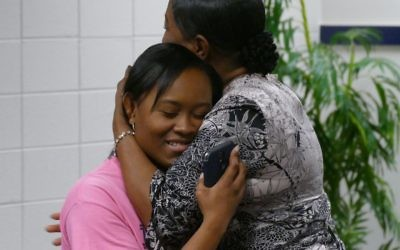 Icesha Sanders gets a congratulatory hug from her mother, Clevette Sanders.