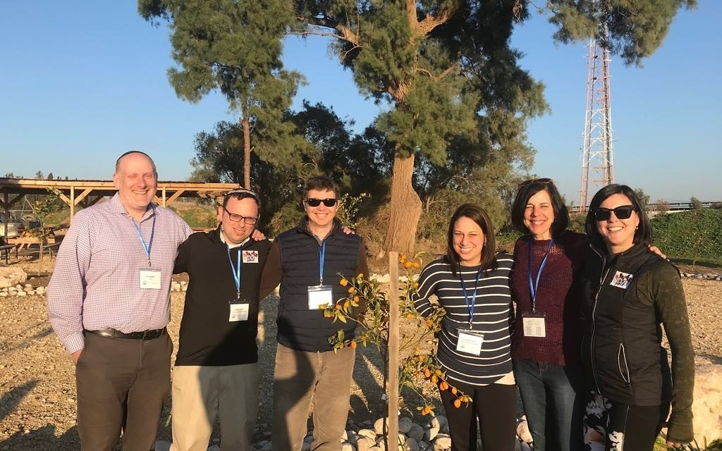 Rabbi Ari Leubitz (left) poses with Rabbi Adam Starr and other Young Israel of Toco Hills representatives on Federation's Front Porch leadership mission to Israel.